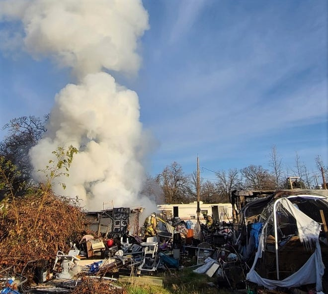 Smoke rises from a fire in a residential area off McElroy Lane Tuesday morning, Jan. 5, 2021 in north Redding.