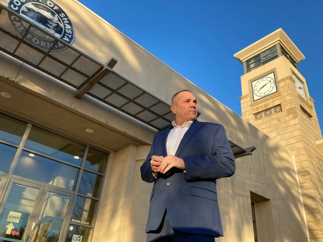 New Shasta County Supervisor Patrick Jones waits outside for his first meeting to begin in January 2021. Jones refused to meet virtually online and instead wanted to hold in-person board meetings.