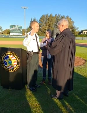 Sheriff Eric Flowers took the oath of office from retired Circuit Judge Robert Pegg during a swearing-in ceremony at Holman Stadium shown live to the public on the Indian River County Sheriff's Office Facebook page at 8 a.m. Jan. 5, 2021. Out of COVID-19 safety concerns, the event was not open to the public.