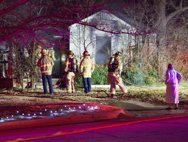 Wichita Falls Firefighters worked to control a house fire Monday night at a home on Taylor Street.