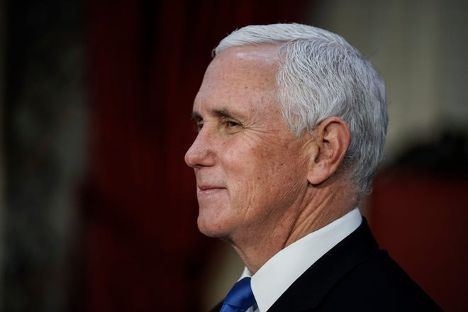 Vice President Mike Pence finishes a swearing-in ceremony for senators in the Old Senate Chamber at the Capitol in Washington, D.C., Sunday, Jan. 3, 2021.