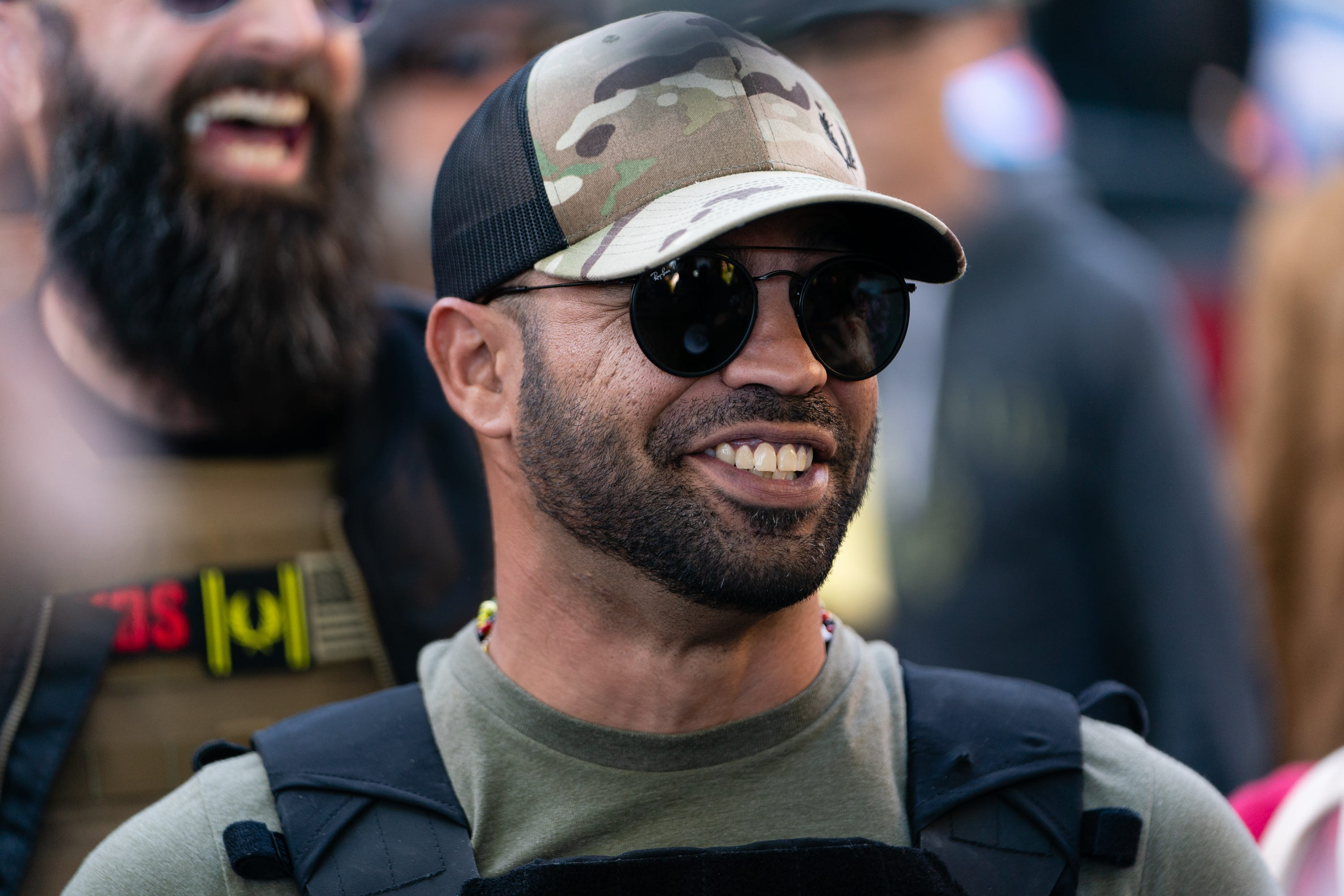 """Enrique Tarrio, leader of the Proud Boys, a far-right group, is seen at a """"Stop the Steal"""" rally against the results of the U.S. presidential election outside the Georgia State Capitol on Nov. 18, 2020, in Atlanta."""