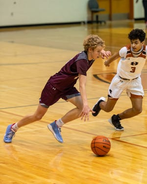 Reese Miller brings the ball up for Round Rock against Jeremiah Washington of Hutto. Round Rock won a District 25-6A boys basketball game 61-45 at Hutto on Tuesday.