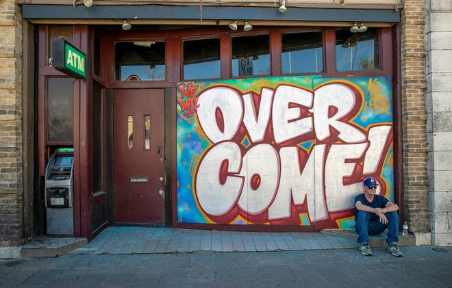 A graffiti art piece adorns an East 6th Street bar on March 24, 2020. Bar owners commissioned artists to use their boarded up business as a canvas amid the coronavirus pandemic.  [JAY JANNER/AMERICAN-STATESMAN]