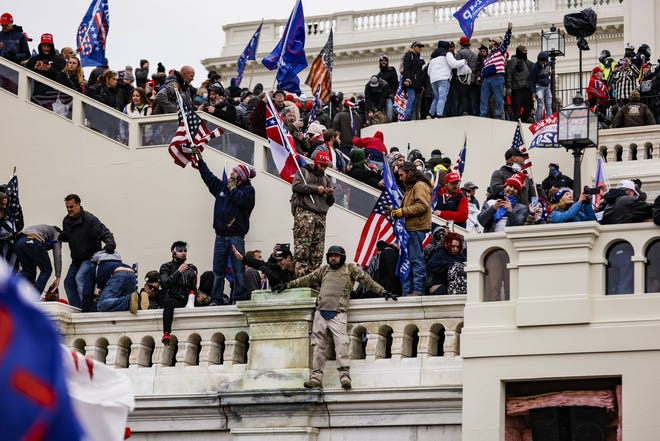 Pro-Trump supporters storm the U.S. Capitol following a rally with President Donald Trump on Wednesday, Jan. 6, 2021.