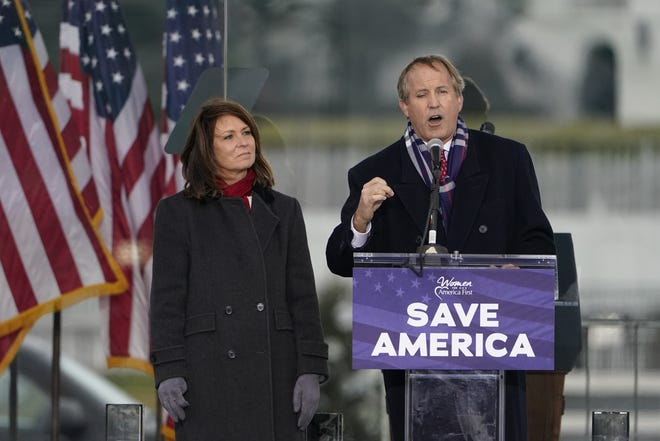 """Texas Attorney General Ken Paxton, with his wife state Sen. Angela Paxton at his side, speaks Wednesday in Washington at """"Save America Rally"""" in support of President Donald Trump."""