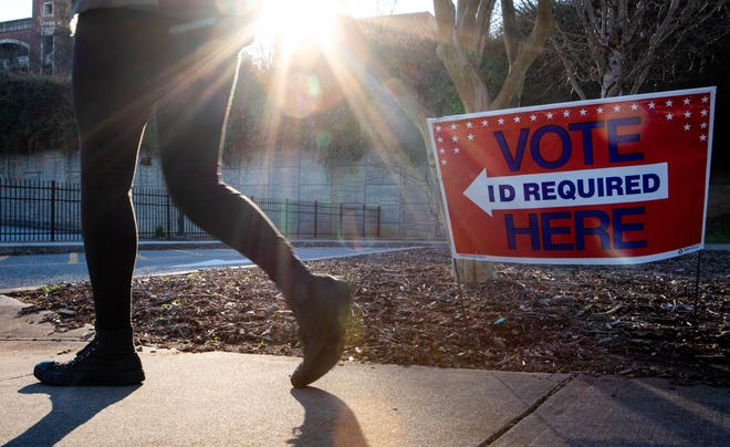 A voter heads to the polls at Athens-Clarke County Transit's Multi-Modal Center in Athens on Tuesday, Jan. 5, 2021. (Casey Sykes for The Athens Banner-Herald)