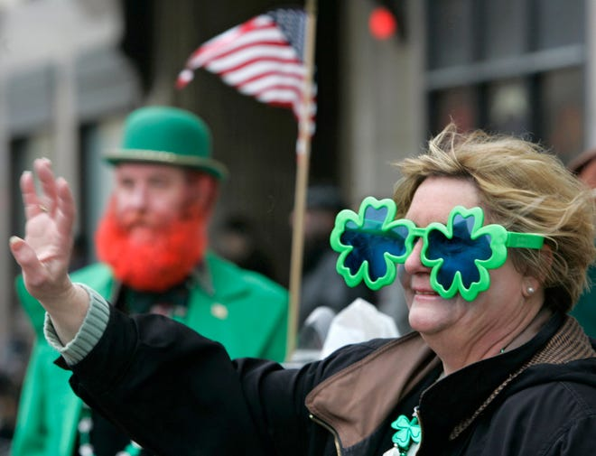 Annette LaClair of Hartville and David Rowles of Akron get into the spirit of the day while attending the 26th annual St. Patrick's Day Parade on Main St. downtown on Saturday, March 11, 2006. The last time the city celebrated St. Patrick's Day with a parade was in 2019.