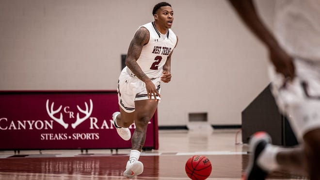 No. 3 West Texas A&M's Qua Grantdribbles down court during Tuesday's win over Oklahoma Baptist, 94-79, at the First United Bank Center. Grant, who led the Buffs with a triple-double, scored 17 points while recording 10 rebounds and 10 assists.