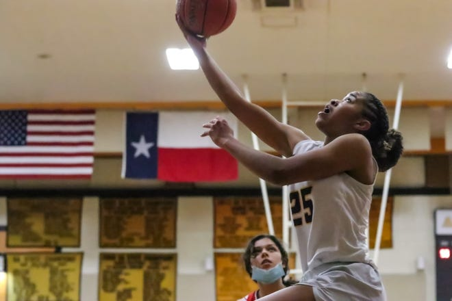 #25 McKenzie Smith jumps up for a lay-up against Tascosa Tuesday night (Ben Jenkins/ Amarillo Globe News)