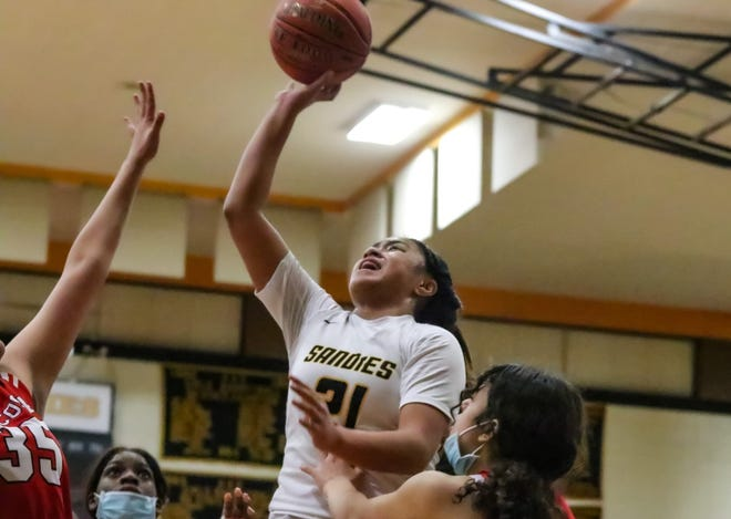 #21 Zeryhia Aokuso jumps up for a lay-up against Tascosa Tuesday night (Ben Jenkins/ Amarillo Globe News)