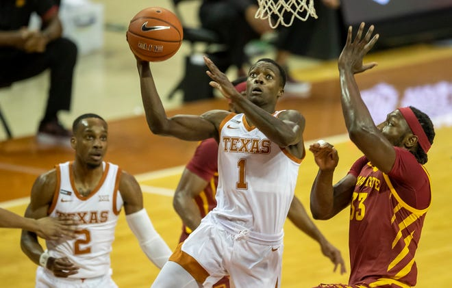 Texas Longhorns guard Andrew Jones (1) drives to the basket against Iowa State Cyclones guard Nate Schuster (23) in the first half of an NCAA college basketball game against Iowa State, Tuesday, Jan. 5, 2021, in Austin, Texas.
