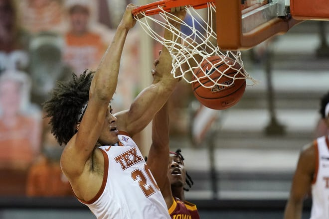 Texas forward Jericho Sims dunks the ball during the first half of Tuesday's win over Iowa State. After a sluggish start to the season, Sims has 21 points and 20 rebounds in the last two games.