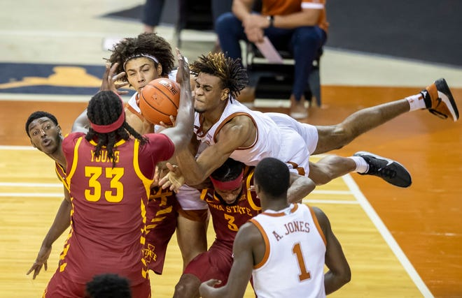 Texas forward Greg Brown battles for a rebound with fellow Longhorn Jericho Sims and Iowa State forward Solomon Young during their game in early January in Austin.