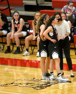 Ashland coach Renee Stimpert talks with Breena Plank (10) and Emma Bell (14) during a stoppage of play in the Arrows' 60-36 loss at Crestview Tuesday night.