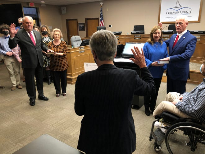 Columbia County probate Judge Alice Padgett administers the oath of office to incoming District 2 Commissioner Don Skinner (left) and returning District 3 Commissioner Gary Richardson before the Columbia County Board of Commissioners meeting Tuesday, Jan. 6, 2021, in Evans.