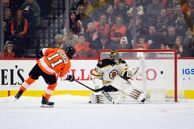 Flyers forward Travis Konecny scores during a shootout against the Bruins.