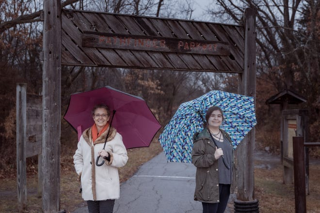 Rachelle Wilson, left, and her mentee, Samantha, at an entrance to the Pathfinder Parkway in Bartlesville.