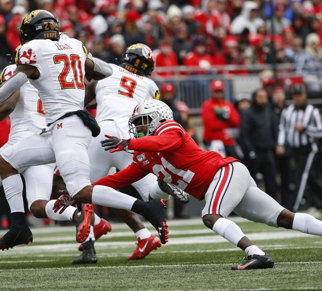 Ohio State Buckeyes cornerback Marcus Williamson (21) attempts to tackle Maryland Terrapins running back Javon Leake (20) during the second quarter of a NCAA Division I college football game between the Ohio State Buckeyes and the Maryland Terrapins on Saturday, November 9, 2019 at Ohio Stadium in Columbus, Ohio. [Joshua A. Bickel/Dispatch]