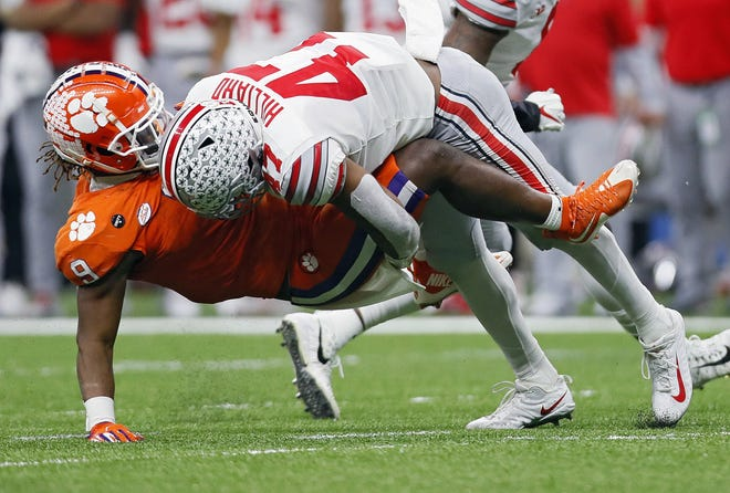 Ohio State linebacker Justin Hilliard shows textbook form in stopping Clemson running back Travis Etienne in the Buckeyes' Sugar Bowl victory on Jan. 1.