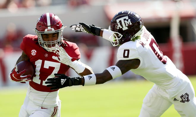 Oct 3, 2020; Tuscaloosa, Alabama, USA; Alabama wide receiver Jaylen Waddle (17) runs after making a catch while Texas A&M defensive back Myles Jones (0) makes the tackle at Bryant-Denny Stadium. Mandatory Credit: Gary Cosby Jr/The Tuscaloosa News via USA TODAY Sports