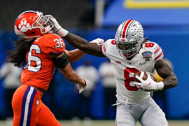 Ohio State running back Trey Sermon runs past Clemson safety Lannden Zanders during the Sugar Bowl on Friday in New Orleans.