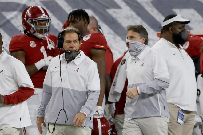 Alabama head coach Nick Saban and assistant coach Steve Sarkisian, right, work from the sidelines during the Rose Bowl on Friday in Arlington, Texas.