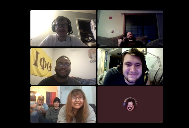 From top left to right: Zach Gee, Matt Terry, Mark Stanley, Zavier Leis, Chris Mitchell, Jacob Blank, Gabriela Velasquez and (unpictured) Alec Stutson smile for a screenshot while watching Wrestle Kingdom 15 over video chat.
