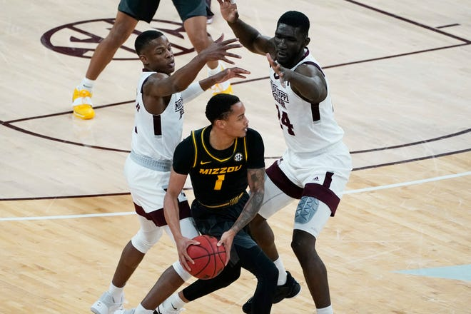 Missouri guard Xavier Pinson (1) looks for help as he is trapped by Mississippi State guard Iverson Molinar, left, and forward Abdul Ado (24) during a game Tuesday at Humphrey Coliseum in Starkville, Miss.