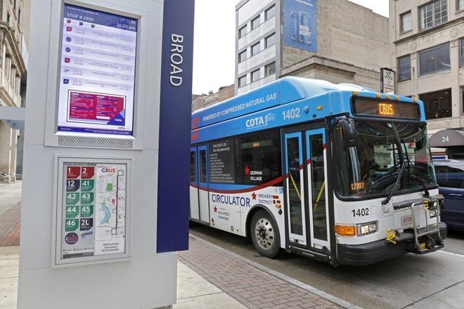 COTA buses come and go near stops along Broad and High streets in downtown Columbus on Friday, March 29, 2019. [Barbara J. Perenic/Dispatch]