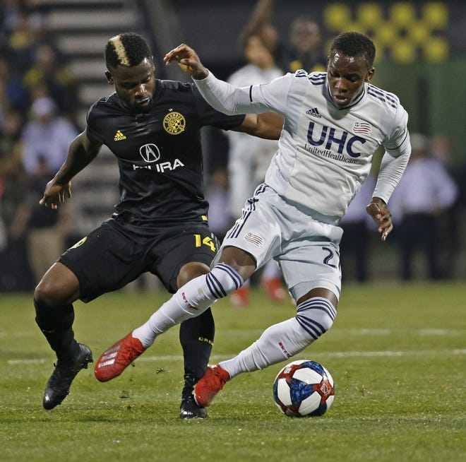 Columbus Crew defender Waylon Francis, seen here in a game against the New England Revolution on April 6, 2019, re-sign with the Crew ahead of the 2021 season.