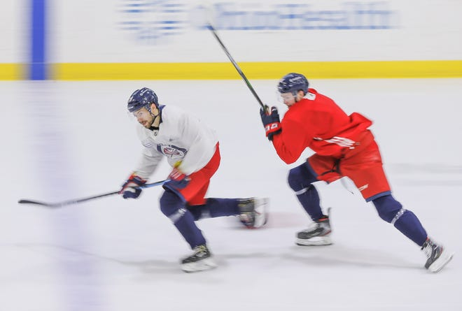 Blue Jackets forward Oliver Bjorkstrand, left, is excited about his standing on the roster and wants to be part of a perennial playoff team in Columbus.