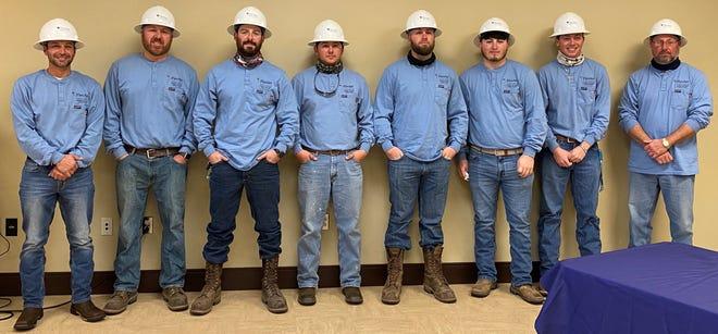 Fletcher College's latest electric-line-woker graduates are (from left) Brent Oubre, Colt Stevens, Ricky Savanna. Jack Blanchard, Jordan Caillouet, Derek Stevens Jr., Nathan Rhodes and Greg Landry.