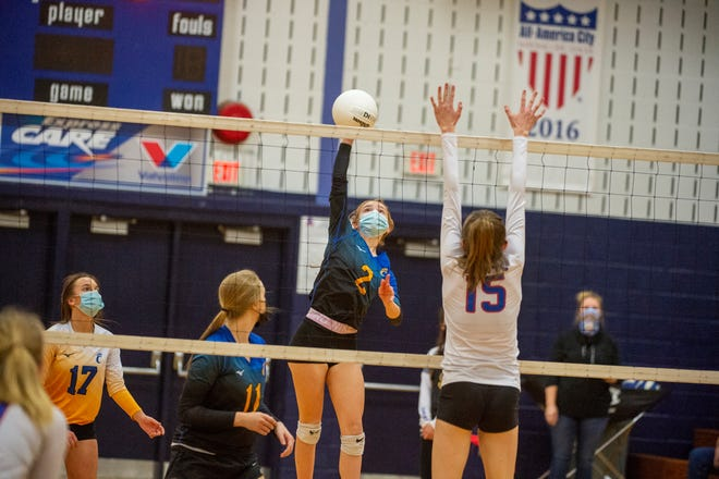 Southwestern Randolph's Coley Shiflet spikes the ball against Asheboro's Claudia Harrell in a cross town rival match on Tuesday. PJ WARD-BROWN/THE COURIER-TRIBUNE
