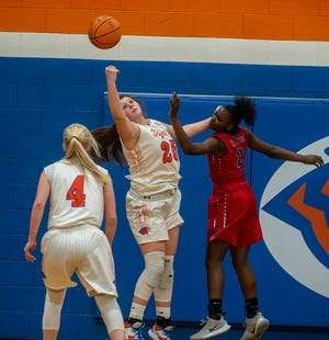 Randleman's Gracyn Hall, shown here in action against High Point Andrews last season, scored 18 points and grabbed 11 rebounds in the Tigers' season-opening 58-41 win over Wheatmore on Tuesday. [PJ Ward-Brown for The Courier-Tribune]