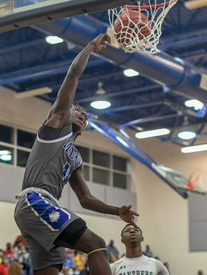 MDCA's Rodney Bryant (0) dunks during Tuesday's game against Eustis at the Panther Den. Bryant scored a game-high 32 points to lead the Bulldogs to a 72-58 win. [PAUL RYAN / CORRESPONDENT]