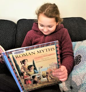 Ana Turner of Millersburg enjoys a good story about Romans. The Turner family enjoys using the  Holmes County Library and is taking part in the Winter Reading Program for kids ages 2-12.