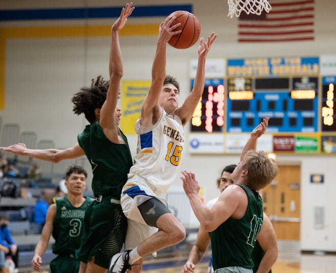 Drew Dossi heads to the basket earlier this season. His return to the court is uncertain after he underwent minor surgery recently.