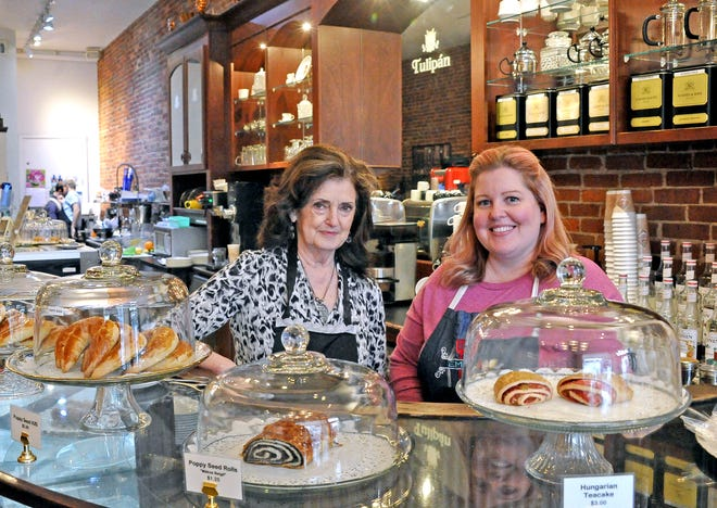 Elizabeth Lakatos, the original owner of Tulipán Hungarian Pastry and Coffee Shop, and Emily Schrull, the new owner, in the business located on the southeast quadrant of the square. Emily Schrull now owns the business with her husband, Mark Schrull.