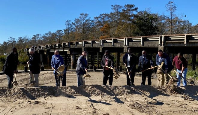 Officials from the state and Lafourche and St. James parishes break ground Dec. 10 on the new Bayou Chevreuil Bridge in Vacherie.