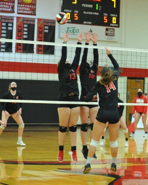 Central Davidson's Paisley Tate (13) and Salem Ward (10) battle South Rowan's McKinley Faw (14) at the net during a match played in November. The two teams will play in the Central Carolina Conference tournament championship on Wednesday. (Photo: Mike Duprez/The Dispatch)