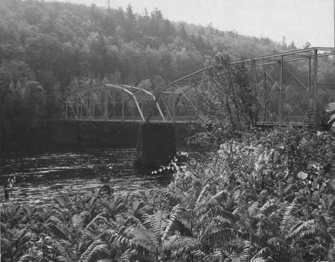 Pond Eddy Bridge, circa 1982. A PennDOT employee took this picture when the suspension bridge, built in 1904-05, as part of the application which led to it being placed on the National Register of Historic Places. The Pennsylvania side is in the background.