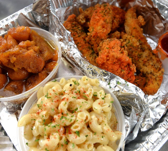A platter of southern fried chicken, sweet candied yams, and white cheddar mac & cheese was prepared by Natasha Pacely on Jan. 6, in the kitchen at the Booker T. Washington Center in Erie.