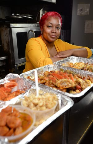 Natasha Pacely, shown Jan. 6, in the kitchen at the Booker T. Washington Center, was homeless at 17. She went on to get a degree in culinary arts from Mercyhurst University and has launched her business, Taste of Love Catering, which will be part of the Flagship City Food Hall.