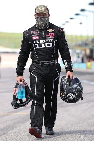Jeffrey Earnhardt, driver of the No. 0 JD Motorsports Chevrolet, walks the grid prior to the NASCAR Xfinity Series Kansas Lottery 250 at Kansas Speedway on July 25, 2020 in Kansas City, Kansas.