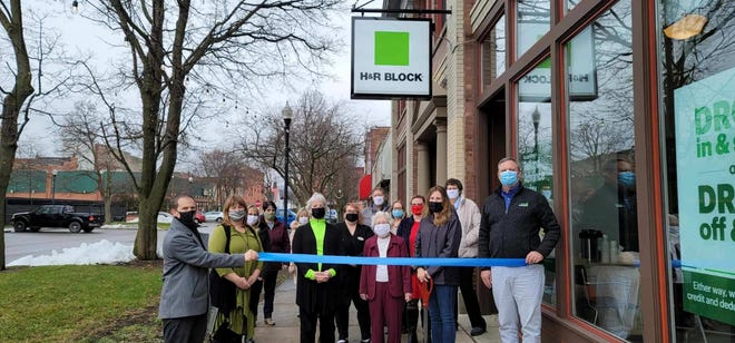Hornell Mayor John Buckley, HPG Chairperson Michelle Pogue and numerous guests and staff help H&R Block cut a ribbon for its new Hornell location at 42 Broadway Mall, on Tuesday, Jan. 5, 2021.