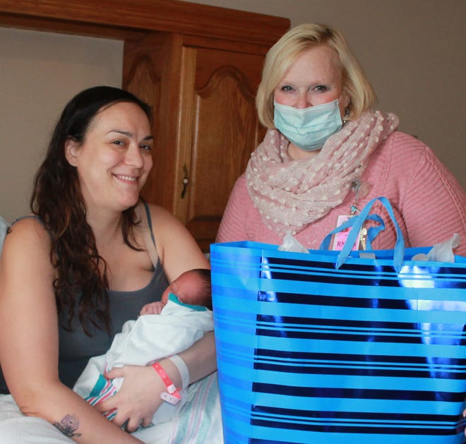 Zavien James Dent is this year's New Year's Baby at Jones Memorial Hospital. Jackie Adrian, RN, right, was delighted to present gifts to mom Sarah Drew and baby Zavien with the best wishes of everyone at Jones Memorial.