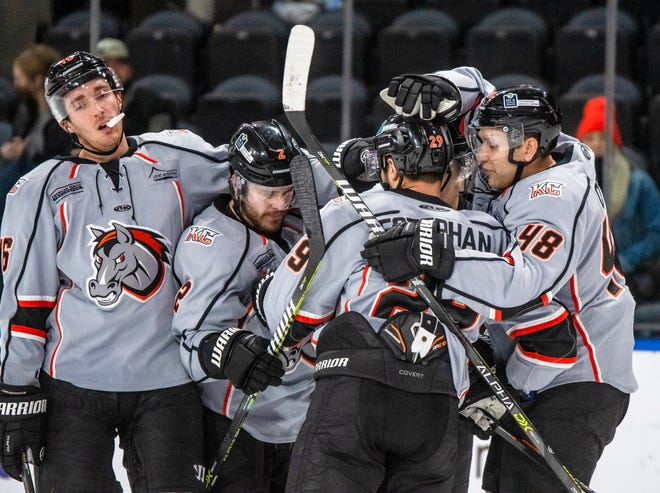 Kansas City Mavericks forward Giorgio Estephan, center, is congratulated by teammates after scoring a third-period goal in Tuesday's ECHL game against the Wichita Thunder at Cable Dahmer Arena. The Mavericks scored two late goals but overcome a big early deficit in an 8-4 loss.