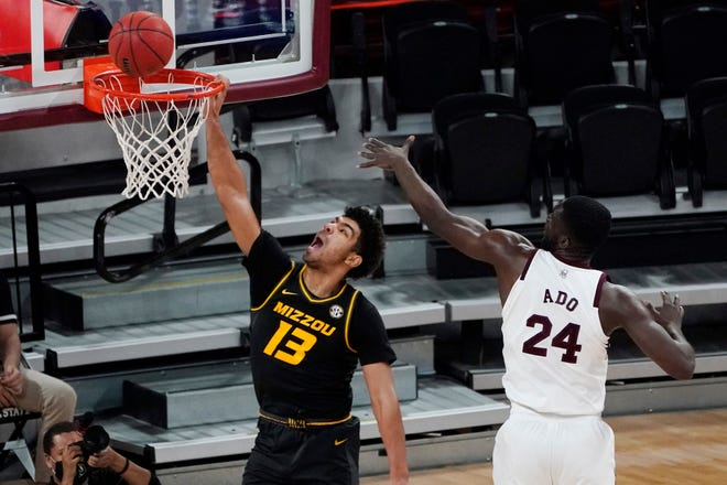 Missouri guard Mark Smith (13) misses on a dunk attempt in a loss to Mississippi State on Jan. 5 The Tigers have been idle since that game because of COVID-19 issues.