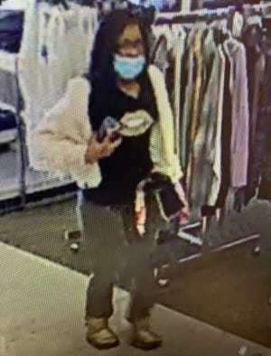 Police are searching for this woman for possible information about Monday's shooting in a parking lot at Independence Center.